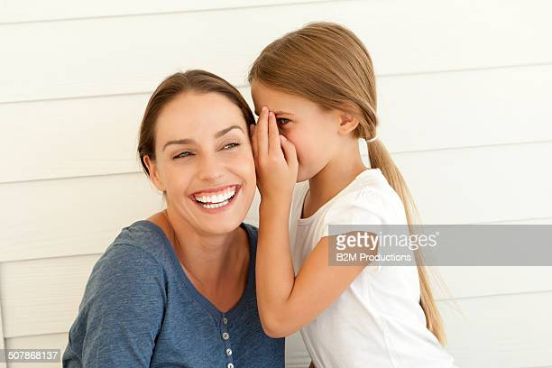 Daughter Whispering In Mother's Ear