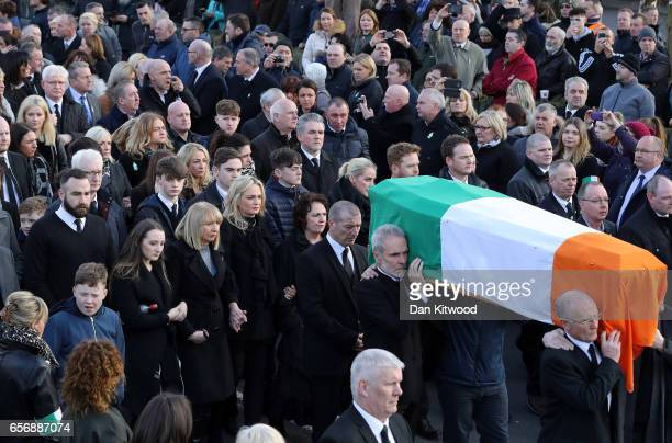 Daughters Fionnuala McGuinness Grainne McGuinness wife Bernadette McGuinness and sons Fiachra McGuinness and Emmett McGuinness walk behind the coffin...