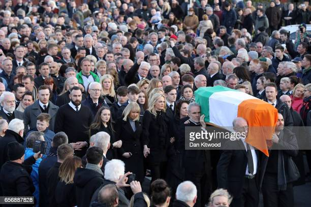 Daughters Fionnuala McGuinness Grainne McGuinness wife Bernadette McGuinness and sons Fiachra McGuinness and Emmett McGuinness lead the mourners as...