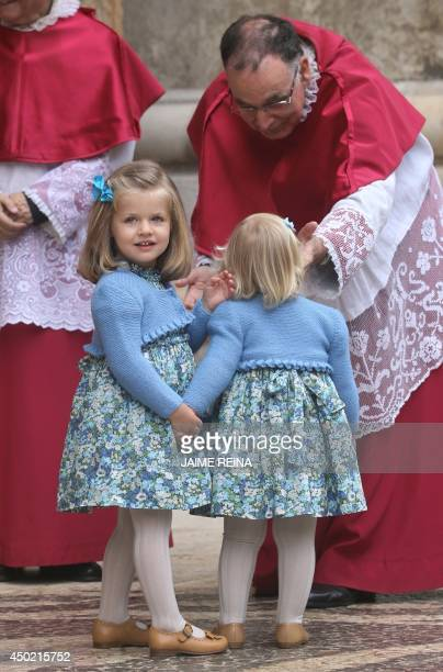 Daughters of Spanish crown Prince and Princess Leonor and Sofia stand before members of the clergy prior to the traditional Mass of the Resurrection...
