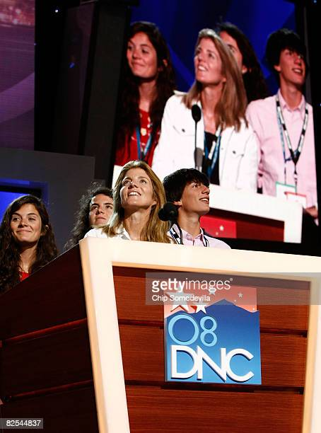 Daughters Rose Schlossberg and Tatiana Schlossberg Caroline Kennedy Schlossberg and son Jack Schlossberg stand at the podium before the first session...
