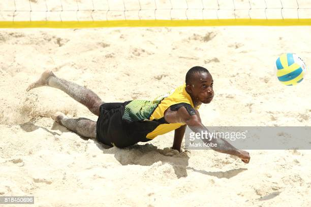 Daunte Smith of Jamaica dives for the ball as he competes in the Boys Beach Volleyball on day 1 of the 2017 Youth Commonwealth Games at Queen...