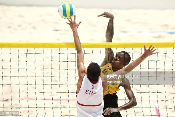 Daunte Smith of Jamaica spikes the ball over Joaquin Bello of England as they competes in the Boys Beach Volleyball on day 1 of the 2017 Youth...