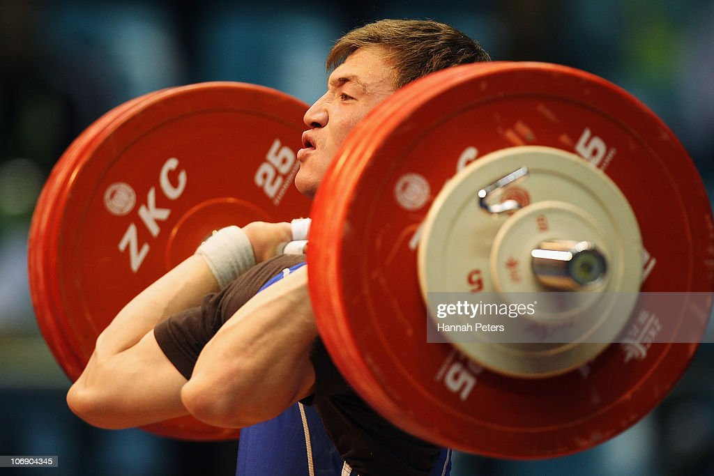 Dauren Shauyeteyev of Kazakhstan competes in the Men's Weightlifting 77kg competition during day four of the 16th Asian Games Guangzhou 2010 at Dongguan Gymnasium on November 16, 2010 in Guangzhou, China.