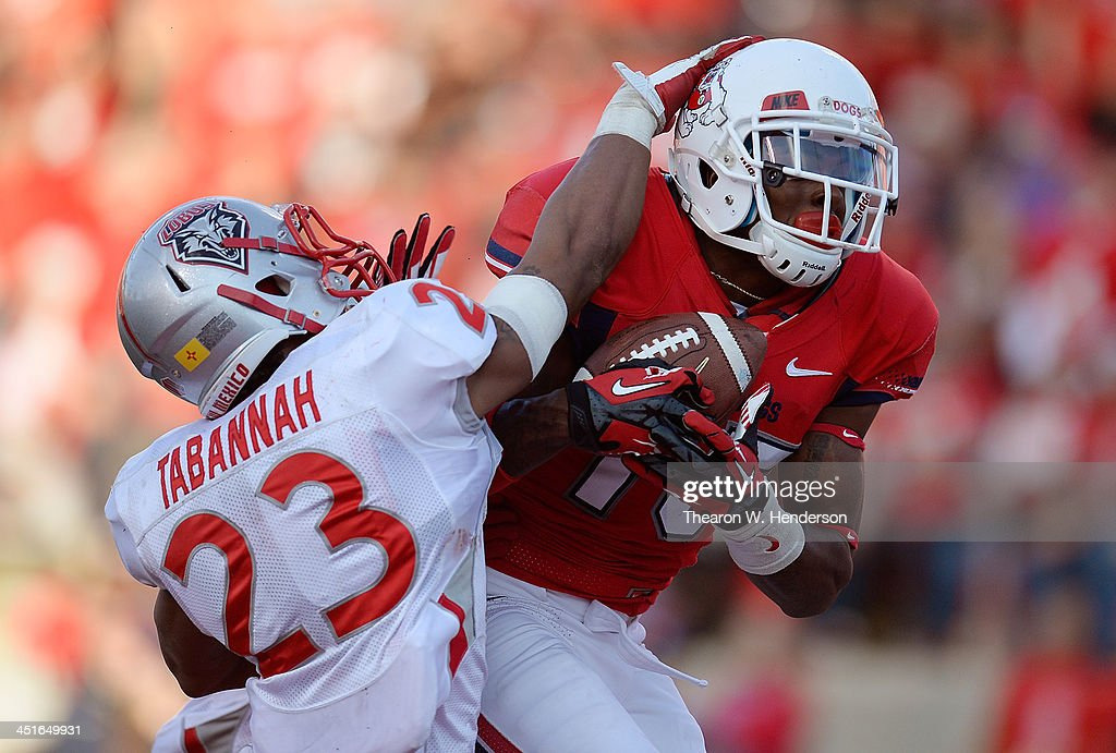 Davante Adams #15 of the Fresno State Bulldogs catches a thirty nine yard touchdown pass over Devonta Tabannah #23 of the New Mexico Lobos during the third quarter at Bulldog Stadium on November 23, 2013 in Fresno, California. Fresno State defeated New Mexico 69-28.