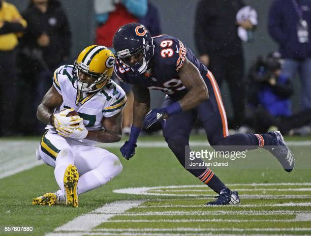 Davante Adams of the Green Bay Packers catches a touchdown pass behind Eddie Jackson of the Chicago Bears at Lambeau Field on September 28 2017 in...