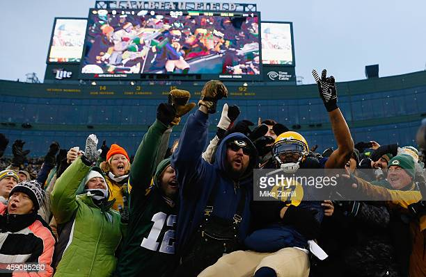 Davante Adams of the Green Bay Packers celebrates his touchdown against the Philadelphia Eagles with fans during the first quarter of the game at...