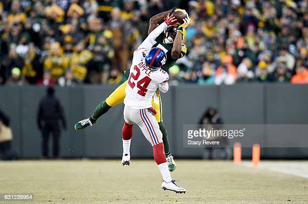 Davante Adams of the Green Bay Packers makes a catch while being guarded by Eli Apple of the New York Giants in the second quarter during the NFC...