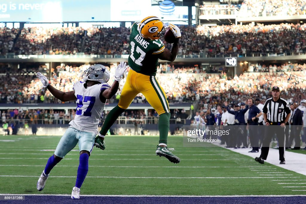 Davante Adams #17 of the Green Bay Packers pulls in the game winning touchdown against Jourdan Lewis #27 of the Dallas Cowboys in the fourth quarter at AT&T Stadium on October 8, 2017 in Arlington, Texas. The Green Bay Packers beat the Dallas Cowboys 35-31.