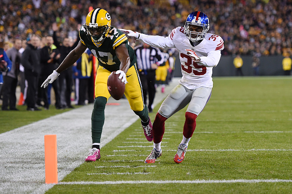 Davante Adams of the Green Bay Packers scores a touchdown in front of Michael Hunter of the New York Giants during the first half of a game at...