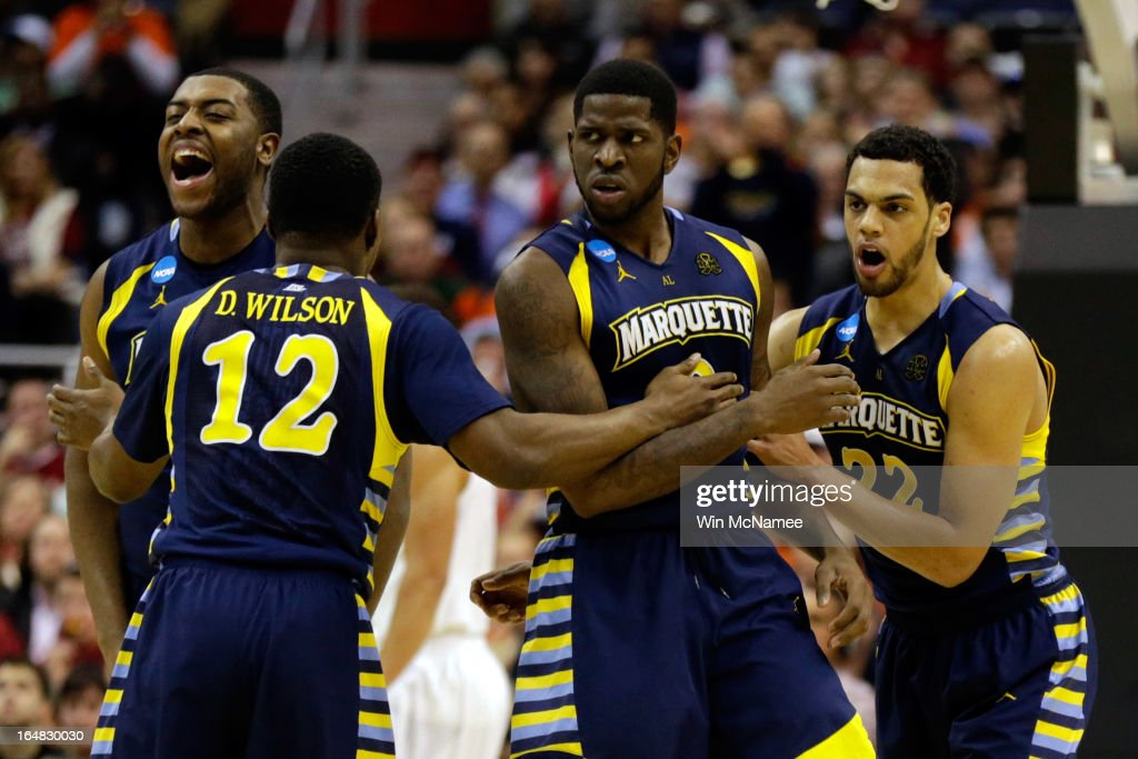 Davante Gardner #54, Derrick Wilson #12 , Jamil Wilson #0 and Trent Lockett #22 of the Marquette Golden Eagles reacts after a play against the Miami (Fl) Hurricanes during the East Regional Round of the 2013 NCAA Men's Basketball Tournament at Verizon Center on March 28, 2013 in Washington, DC.