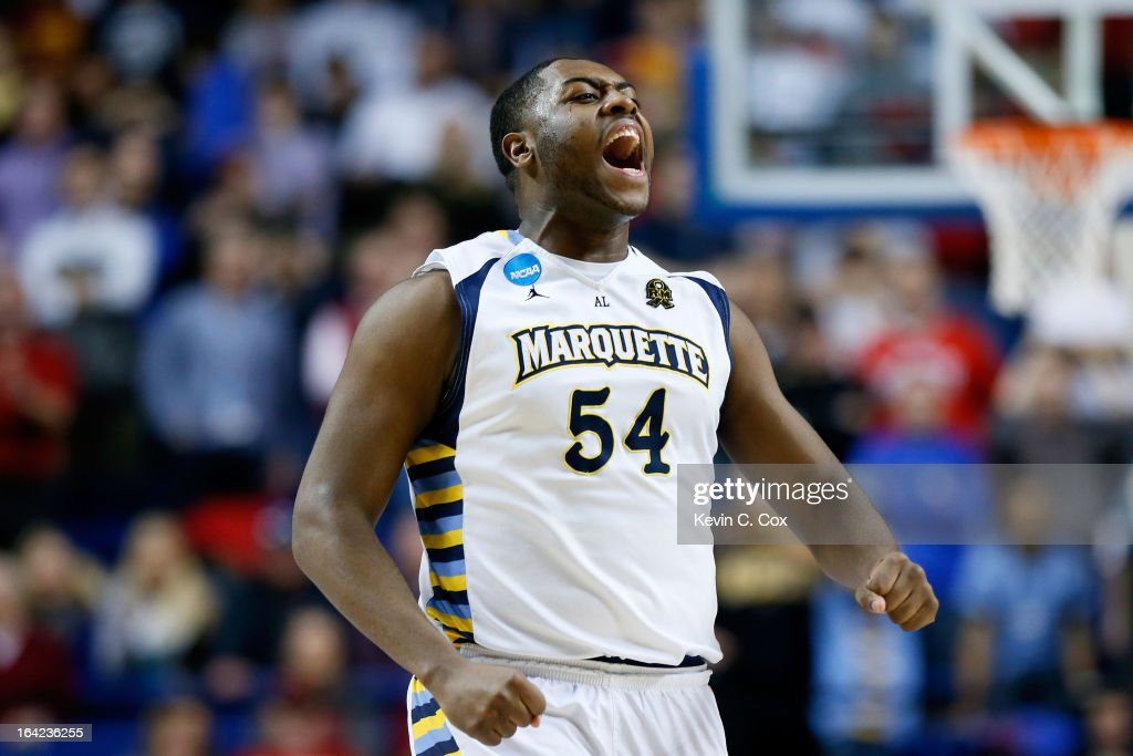 Davante Gardner #54 of the Marquette Golden Eagles celebrates a game-winning basket by teammate Vander Blue #13 against the Davidson Wildcats during the second round of the 2013 NCAA Men's Basketball Tournament at the Rupp Arena on March 21, 2013 in Lexington, Kentucky.