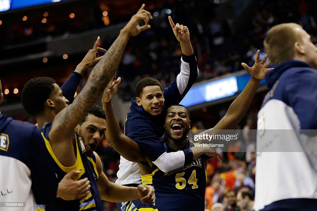 Davante Gardner #54 of the Marquette Golden Eagles celebrates with his team after defeating the Miami (Fl) Hurricanes during the East Regional Round of the 2013 NCAA Men's Basketball Tournament at Verizon Center on March 28, 2013 in Washington, DC.