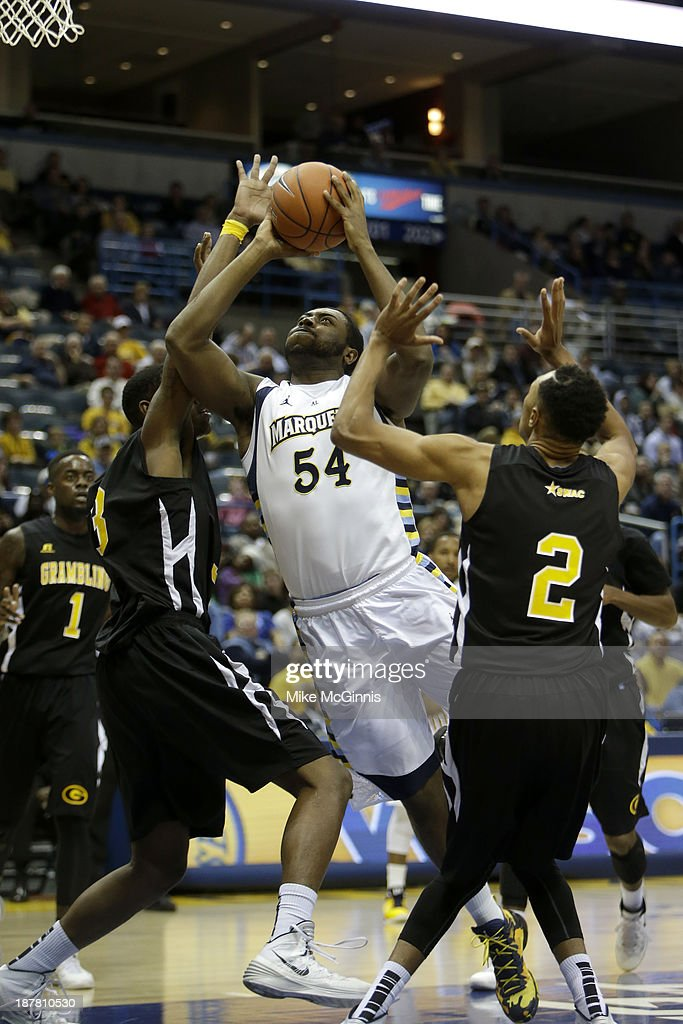 Davante Gardner #54 of the Marquette Golden Eagles draws the foul while driving to the hoop during the first half of play against the Grambling State Tigers at BMO Harris Bradley Center on November 12, 2013 in Madison, Wisconsin.