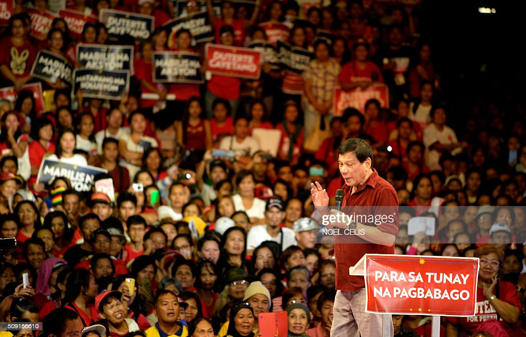Davao City mayor and presidential candidate Rodrigo Duterte states his political platform during his party's proclamation rally in Manila on February 9, 2016. A cliffhanger race to lead the Philippines began February 9 with the adopted daughter of a dead movie star and a tough-talking politician who claims to kill criminals among the top contenders. AFP PHOTO / NOEL CELIS / AFP / NOEL CELIS