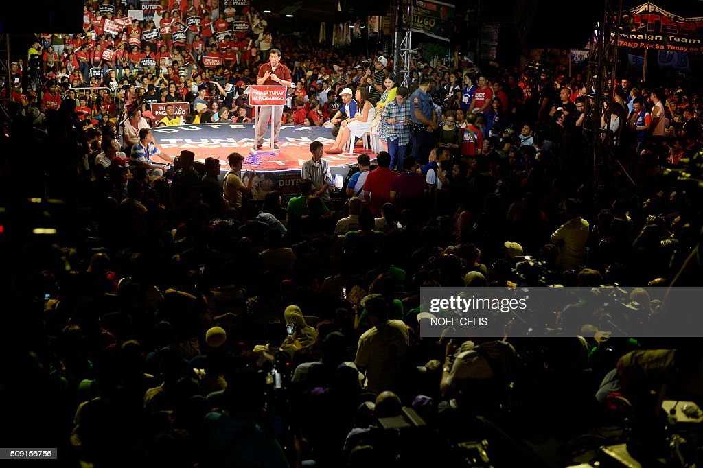 Davao City mayor and presidential candidate Rodrigo Duterte's states his political platform during his party's proclamation rally in Manila on February 9, 2016. A cliffhanger race to lead the Philippines began February 9 with the adopted daughter of a dead movie star and a tough-talking politician who claims to kill criminals among the top contenders. AFP PHOTO / NOEL CELIS / AFP / NOEL CELIS