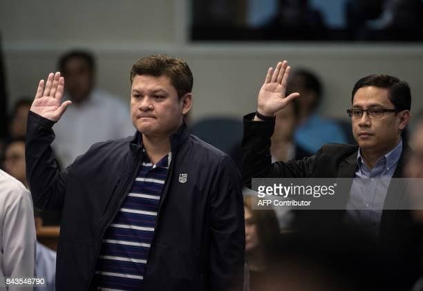 Davao City Vice Mayor Paolo Duterte son of Philippine President Rodrigo Duterte and the president's soninlaw Manases Carpio take an oath as they...