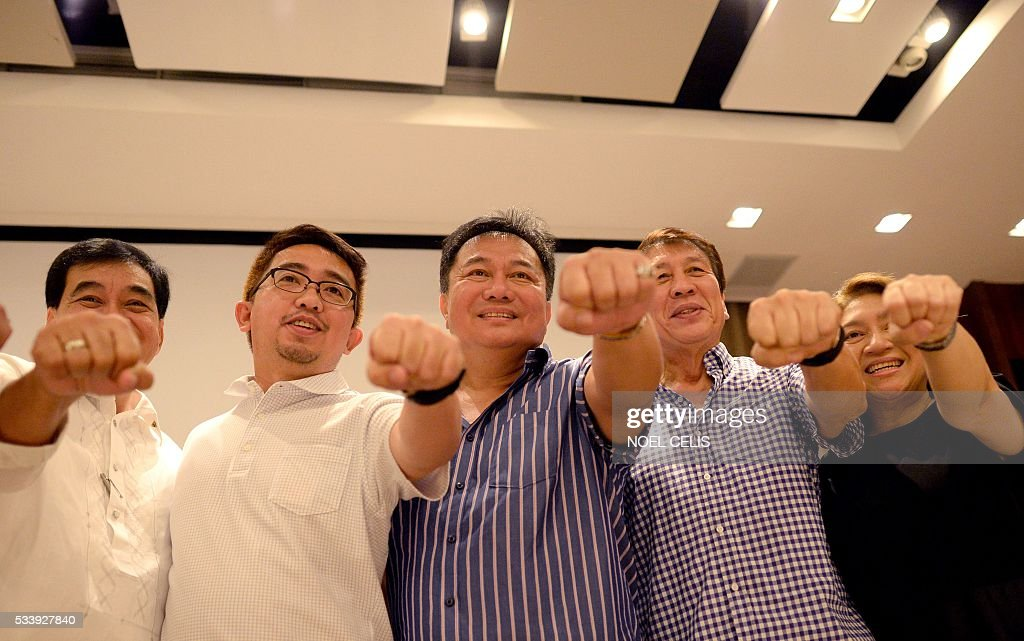 Davao Del Norte Representative Pantaleon Alvarez (C) of the Partido Demokratiko Pilipino-Lakas ng Bayan (PDP-Laban) pose for a picture after officiating an oath taking of Mindanao lawmakers as new members of PDP-LABAN, the political party of Philippines' president-elect Rodrigo Duterte, at a hotel in Manila on May 24, 2016. Business titans, turncoat politicians, celebrities and rebel leaders are descending on the long-neglected far southern Philippines, hoping to gain favour with the nation's shock new powerbroker. The remote and dusty city of Davao has suddenly become the country's new seat of power after hometown hero Rodrigo Duterte won last week's presidential election in a landslide. / AFP / NOEL