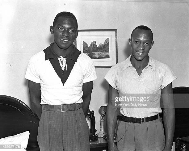 Dave Albritton who broke High Jump record and Jesse Owens who won 100 meter 200 meter and Broadjump events pose at Hotel Lincoln before departing for...