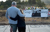 Dave and Robin Griffiths leave flowers at a memorial along the road to Umpqua Community College on October 3 2015 in Roseburg Oregon On Thursday...