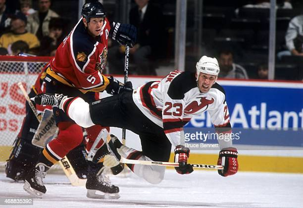 Dave Andreychuk of the New Jersey Devils looks to be tripped up by Gord Murphy of the Florida Panthers circa 1999 at the Continental Airlines Arena...