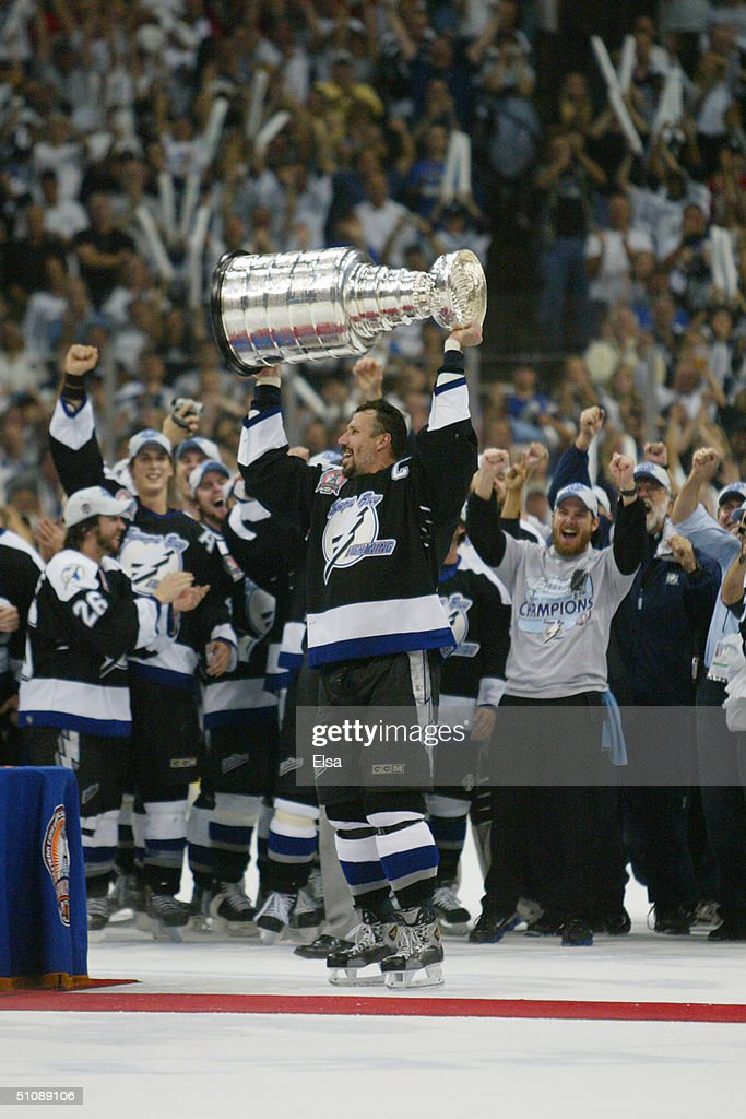 Dave Andreychuk #25 of the Tampa Bay Lightning holds the Stanley Cup above his head after the victory over the Calgary Flames in Game seven of the NHL Stanley Cup Finals on June 7, 2004 at the St. Pete Times Forum in Tampa, Florida. The Lightning defeated the Flames 2-1.