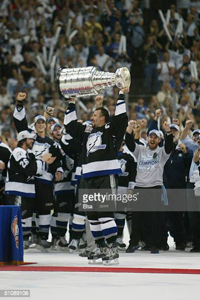 Dave Andreychuk of the Tampa Bay Lightning holds the Stanley Cup above his head after the victory over the Calgary Flames in Game seven of the NHL...