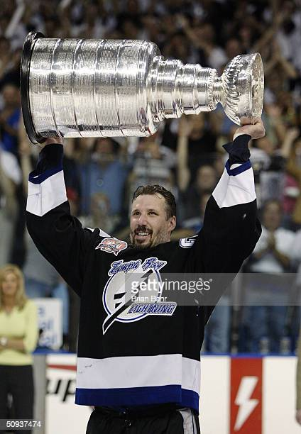 Dave Andreychuk of the Tampa Bay Lightning skates with the Stanley Cup after defeating the Calgary Flames in game seven of the NHL Stanley Cup Finals...