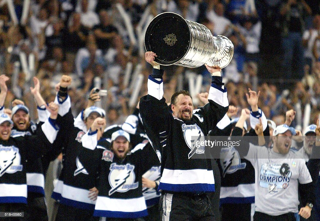 Dave Andreychuk #25 of the Tampa Bay Lightning skates with the Stanley Cup after defeating the Calgary Flames in game seven of the NHL Stanley Cup Finals on June 7, 2004 at the St. Pete Times Forum in Tampa, Florida. The Lightning won the Stanley cup by defeating the Flames 2-1.