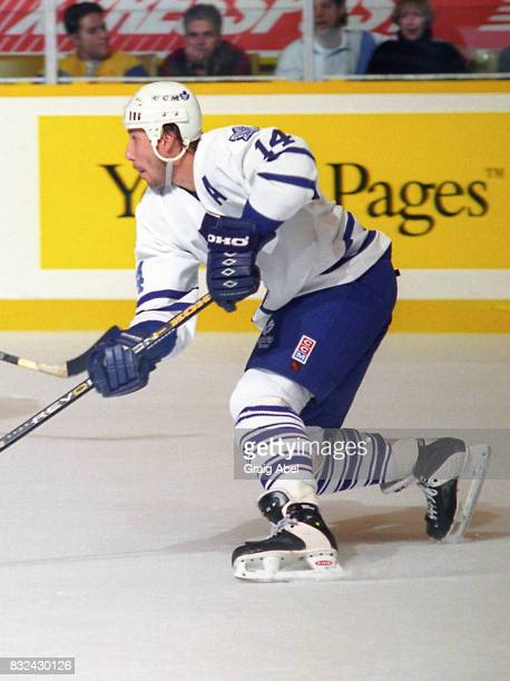 Dave Andreychuk of Toronto Maple Leafs skates up ice against the New York Rangers during NHL game action on October 14 1995 at Maple Leaf Gardens in...