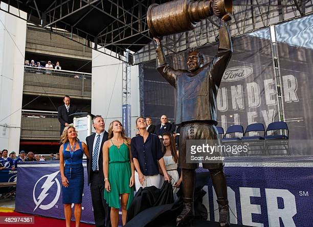 Dave Andreychuk's daughters unveil his bronze statue outside of the Tampa Bay Times Forum before the start of the game between the Tampa Bay...