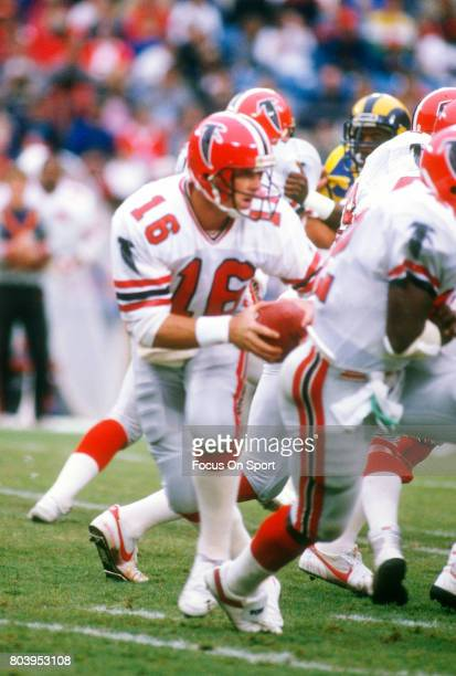 Dave Archer of the Atlanta Falcons drops back to pass against the Los Angeles Rams during an NFL football game October 26 1986 at Anaheim Stadium in...