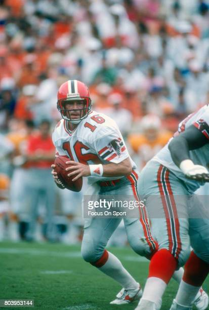 Dave Archer of the Atlanta Falcons drops back to pass against the Tampa Bay Buccaneers during an NFL football game September 13 1987 at Tampa Stadium...