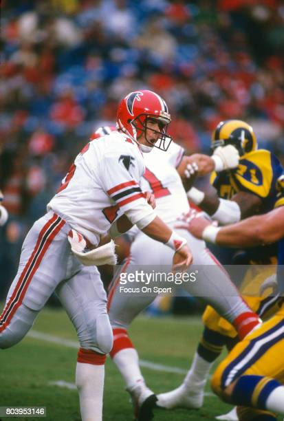 Dave Archer of the Atlanta Falcons throws a pass against the Los Angeles Rams during an NFL football game October 26 1986 at Anaheim Stadium in...