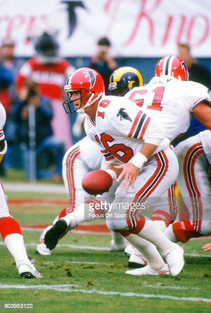 Dave Archer of the Atlanta Falcons turns to hand off to a running back against the Los Angeles Rams during an NFL football game October 26 1986 at...