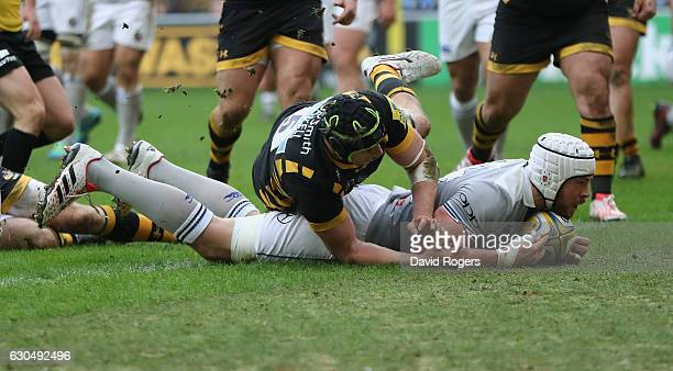 Dave Attwood of Bath dives over for their second try during the Aviva Premiership match between Wasps and Bath Rugby at The Ricoh Arena on December...