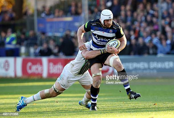Dave Attwood of Bath Rugby evades the Harlequins defence during the Aviva Premiership match between Bath Rugby and Harlequins at the Recreation...