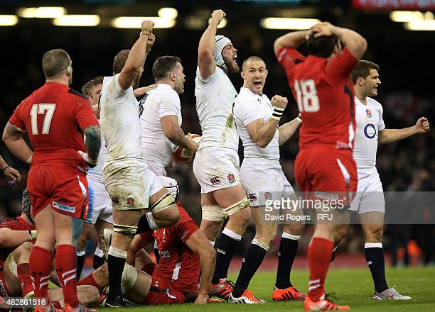 Dave Attwood of England and his teammates celebrate their team's 2116 victory as the final whistle blows during the RBS Six Nations match between...