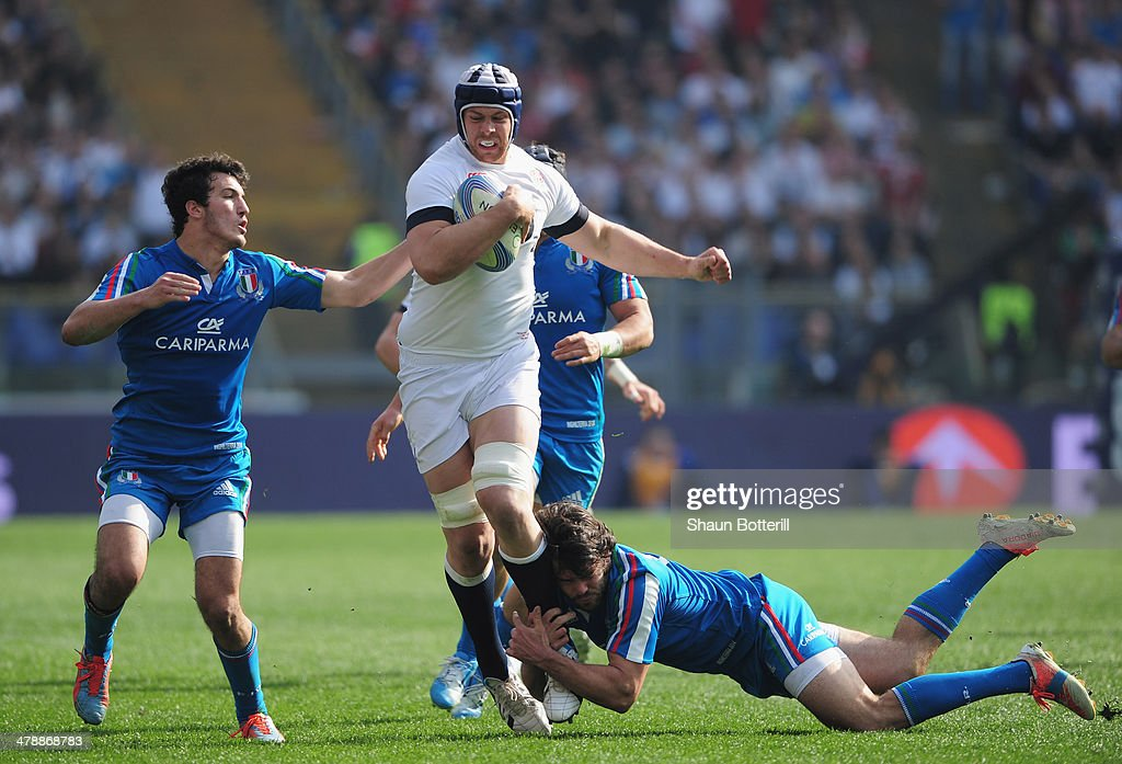 <a gi-track='captionPersonalityLinkClicked' href=/galleries/search?phrase=Dave+Attwood&family=editorial&specificpeople=4134653 ng-click='$event.stopPropagation()'>Dave Attwood</a> of England is tackled by <a gi-track='captionPersonalityLinkClicked' href=/galleries/search?phrase=Luke+McLean&family=editorial&specificpeople=5700811 ng-click='$event.stopPropagation()'>Luke McLean</a> and Leonardo Sarto of Italy during the RBS Six Nations match between Italy and England at Stadio Olimpico on March 15, 2014 in Rome, Italy.