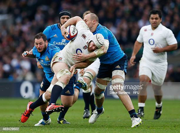 Dave Attwood of England is tackled by Sergio Parisse of Italy during the RBS Six Nations match between England and Italy at Twickenham Stadium on...