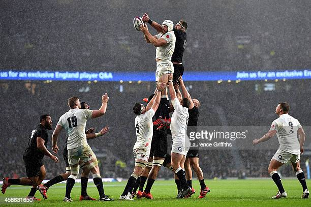 Dave Attwood of England jumps for the lineout ball with Kieran Read of New Zealand during the QBE International match between England and New Zealand...