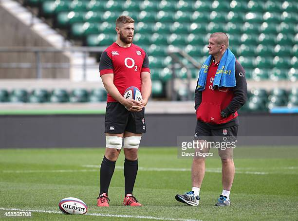 Dave Attwood talks to forwards coach Graham Rowntree during the England captain's run at Twickenham Stadium on November 7 2014 in London England