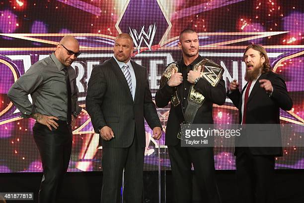 Dave Batista Triple H Randy Orton and Daniel Bryan attend the WrestleMania 30 press conference at the Hard Rock Cafe New York on April 1 2014 in New...