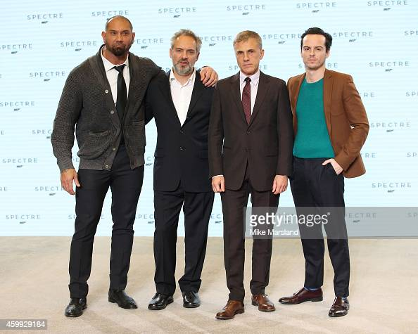Dave Bautista Director Sam Mendes Christoph Waltz and Andrew Scott attend a photocall for the new James Bond film Spectre at Pinewood Studios on...
