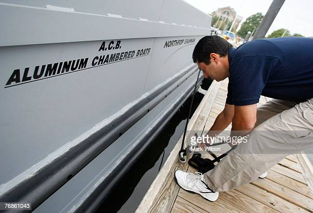 Dave Berlino unties a dockline before getting underway on a 41 foot prototype boat named the Joint Multimission Expeditionary Craft during a...