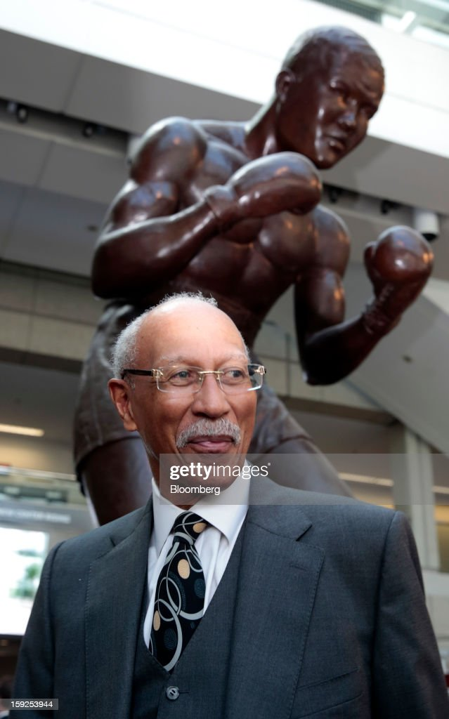 Dave Bing, mayor of Detroit, stands under a statue of boxer Joe Louis before an advance tour of the North American International Auto Show (NAIAS) at Cobo Hall in Detroit, Michigan, U.S., on Thursday, Jan. 10, 2013. More than 23,000 attendees representing almost 2,000 companies are expected to attend the industry preview for NAIAS on Jan. 16-17. The general public can attend the show from Jan. 19-27. Photographer: Jeff Kowalsky/Bloomberg via Getty Images