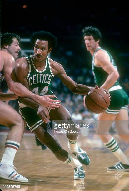 Dave Bing of the Boston Celtics drives on the Washington Bullets during an NBA basketball game circa 1977 at the Baltimore Civic Center in Baltimore...
