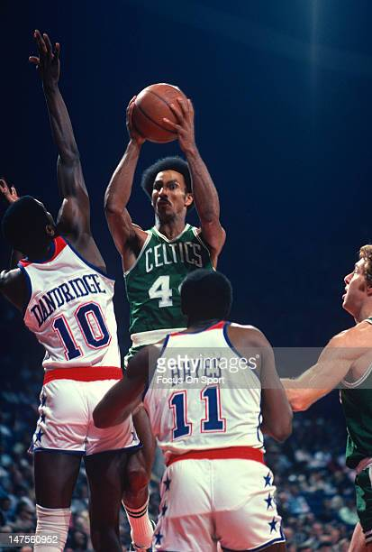 Dave Bing of the Boston Celtics shoots over Bob Dandridge of the Washington Bullets during an NBA basketball game circa 1977 at the Capital Centre in...