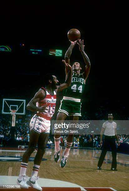 Dave Bing of the Boston Celtics shoots over Charle Johnson of the Washington Bullets during an NBA basketball game circa 1977 at the Baltimore Civic...