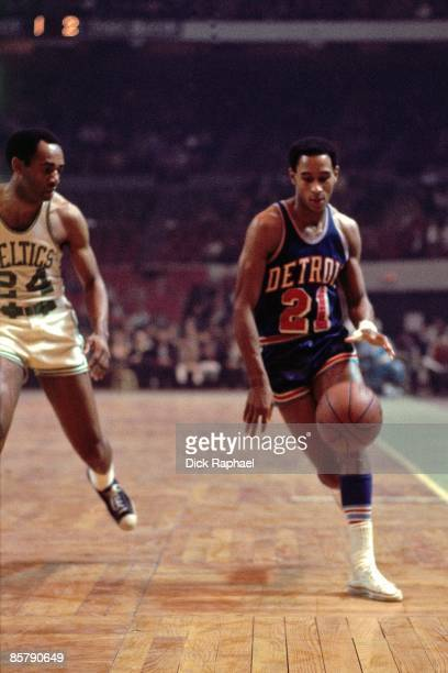Dave Bing of the Detroit Pistons moves the ball up court against Sam Jones of the Boston Celtics during a game played in 1968 at the Boston Garden in...